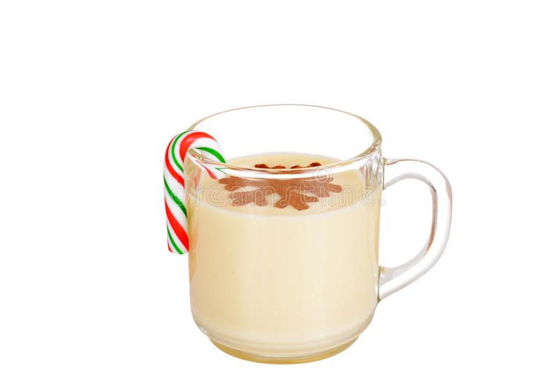 Eggnog with a candy cane. Isolated eggnog with a candy cane stock images