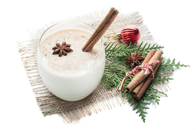 eggnog cocktail in glass arranged with christmas decoration isolated on white background royalty free stock photo