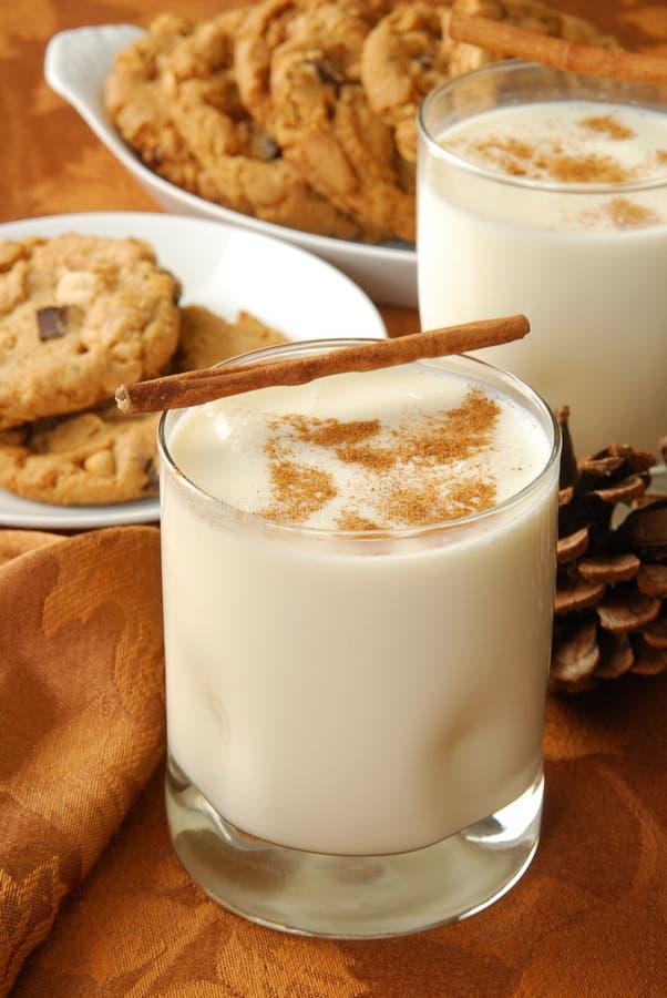 Eggnog and cookies stock photos