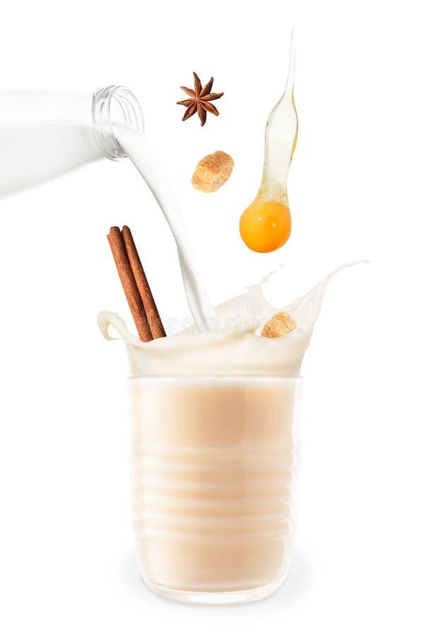 Eggnog with splash isolated on white royalty free stock photography