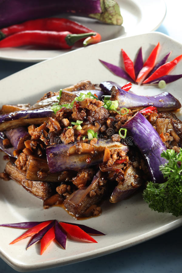 Eggplant. Chinese spicy eggplant cuisine with plate stock image