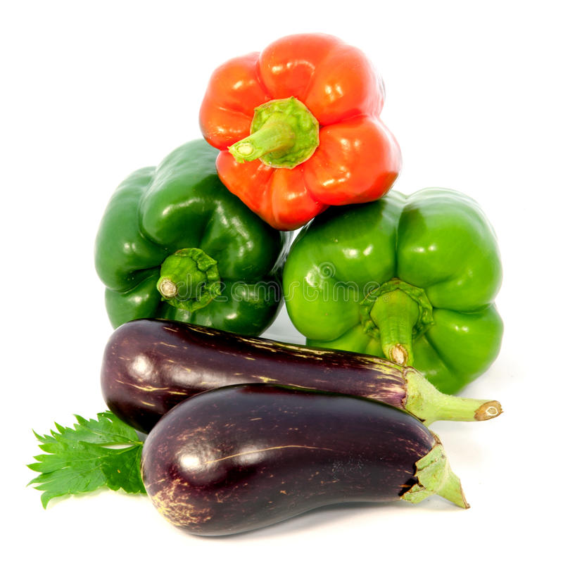 Eggplant and colorful peppers on white background royalty free stock image
