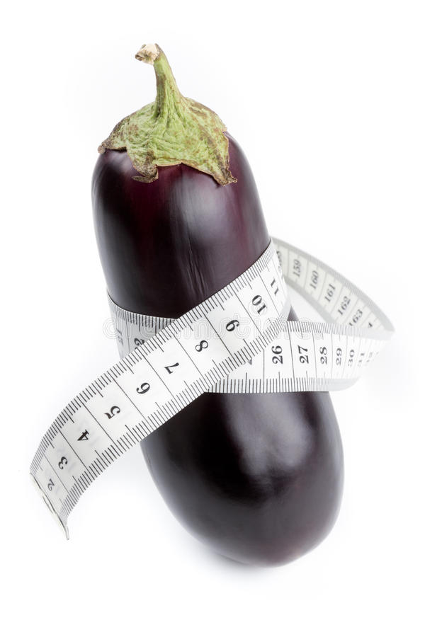 Eggplant with measuring tape stock images