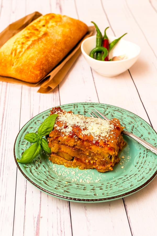 Eggplant with parmesan in a plate traditional Italian recipe royalty free stock photos