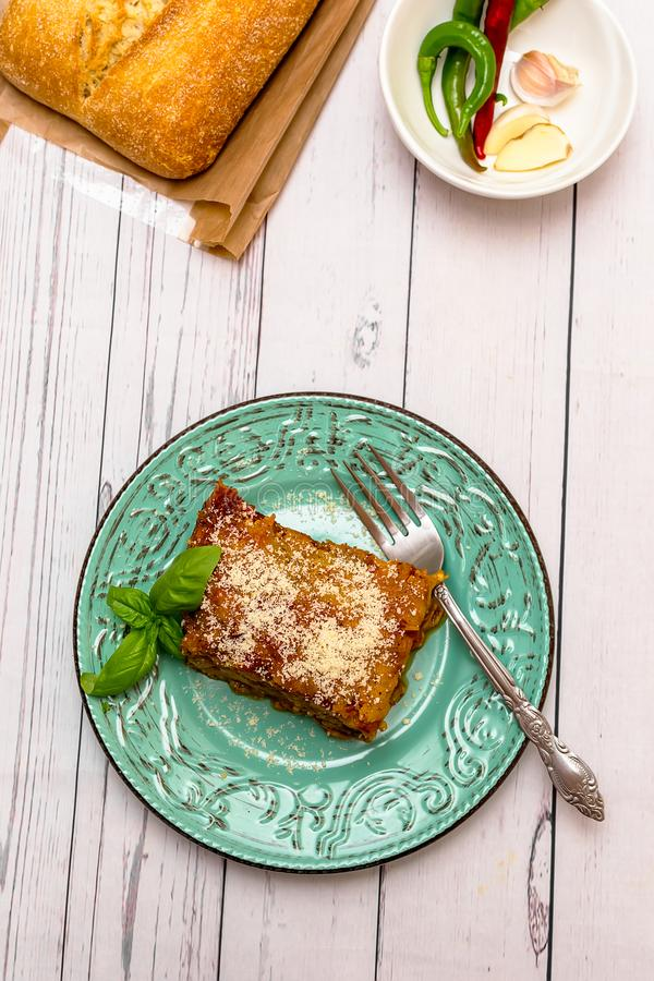Eggplant with parmesan in a plate traditional Italian recipe stock images
