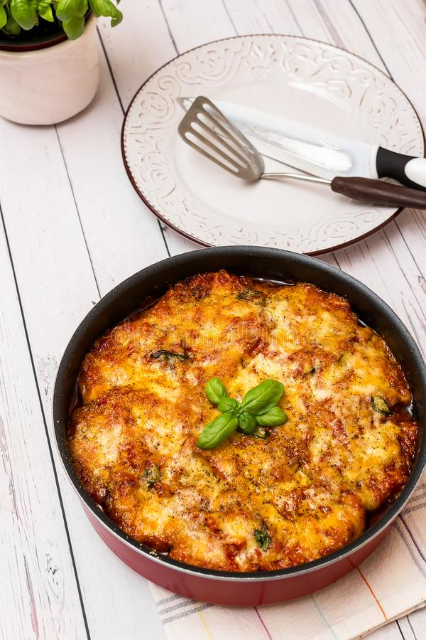 Eggplant with parmesan in a tray traditional Italian recipe stock photo