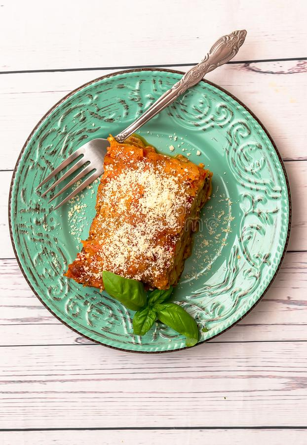 Eggplant with parmesan in a plate traditional Italian recipe stock photos