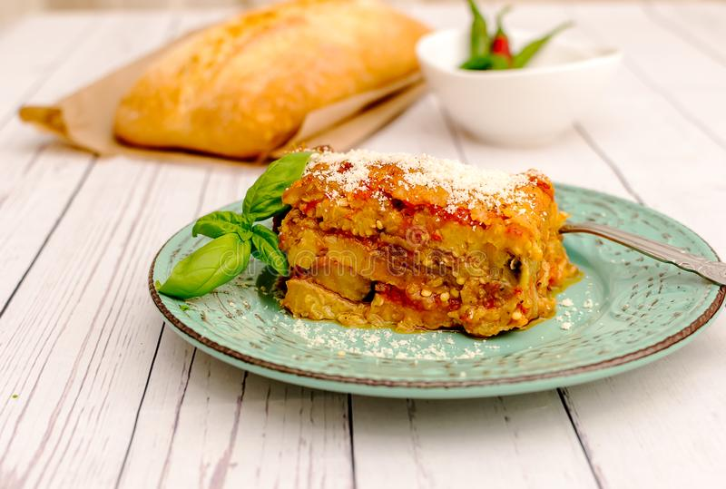 Eggplant with parmesan in a plate traditional Italian recipe stock photo