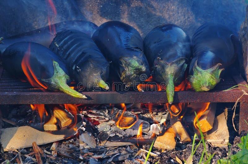 Eggplant roasting royalty free stock images