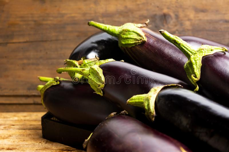Eggplant on a rustic wooden table stock image