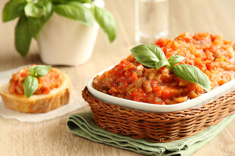 Eggplant Salad (caviar) In Bowl With Basil Leaves Stock Photo