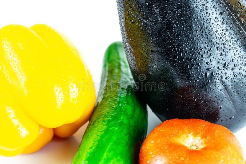 Eggplant, tomato, cucumber, paprika isolated on white blackboard. Organic vegetables. Healthy eating concept. Cucumber, Eggplant, Tomato, Paprika isolated on royalty free stock image