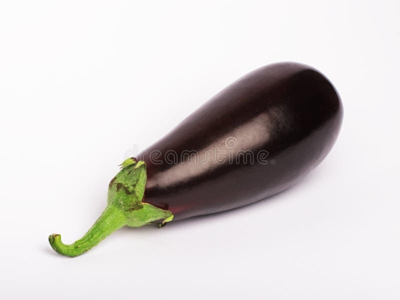 Eggplant vegetable. An eggplant vegetable isolated on white stock image