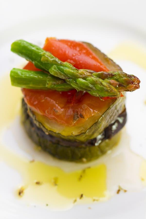Eggplant with zucchini, tomato, asparagus royalty free stock photo