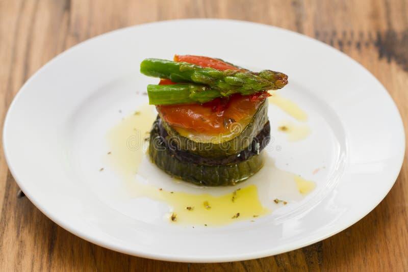 Eggplant with zucchini, tomato, asparagus royalty free stock photos