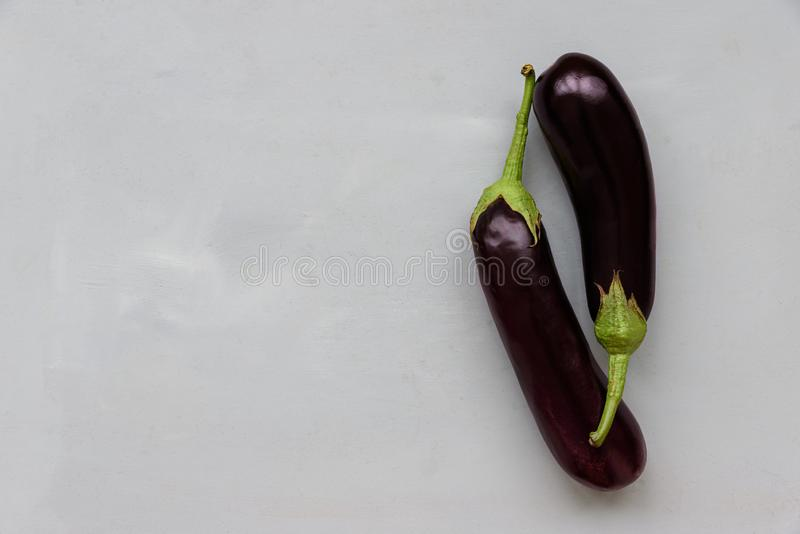 Eggplants on gray wooden background. Top view. Flat lay. Harvesting or healthy food concept.  stock photos