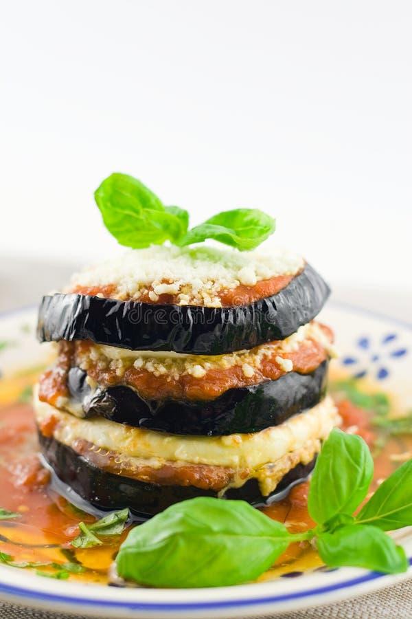 Eggplants parmigiana stock photography