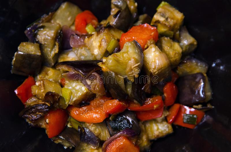 Eggplants and pepper with garlic, onion and soy sause, chinese recipe royalty free stock photography