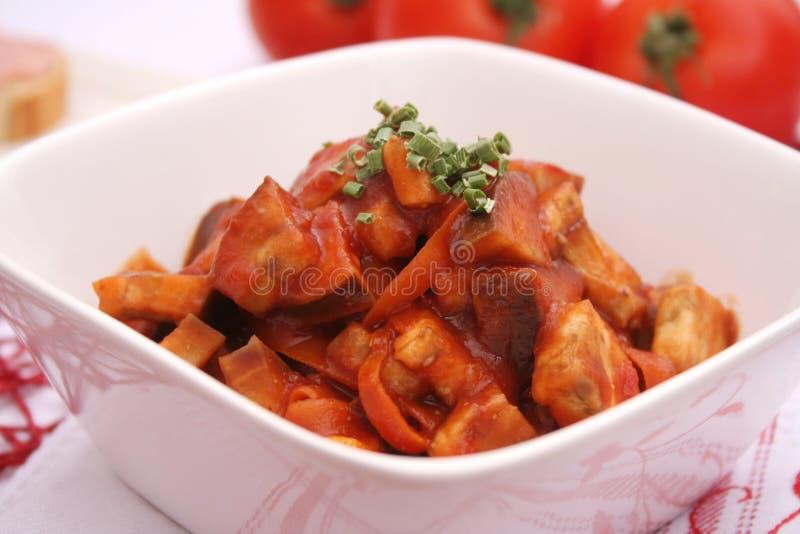 Eggplants with tomatoes stock photos