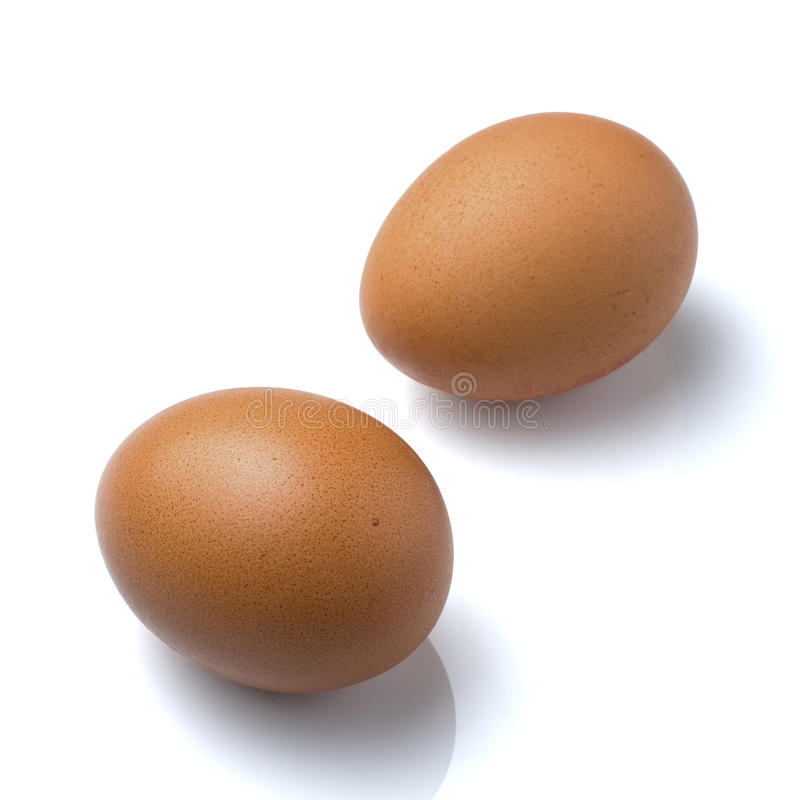 Eggs brown whole stock photography