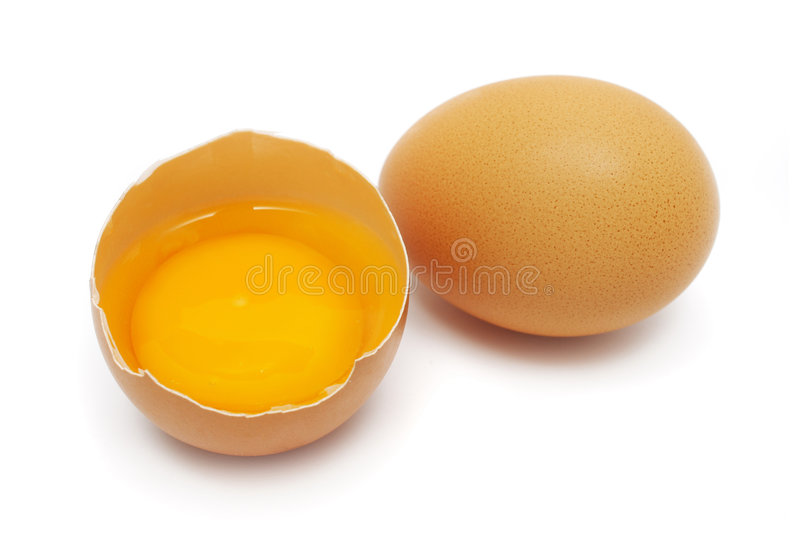 Eggs. An half egg with yolk and albumin put together with another royalty free stock photography