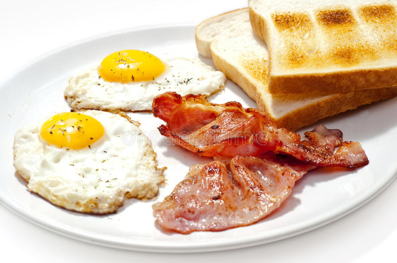 Eggs bacon and toast breakfast. Isolated stock image
