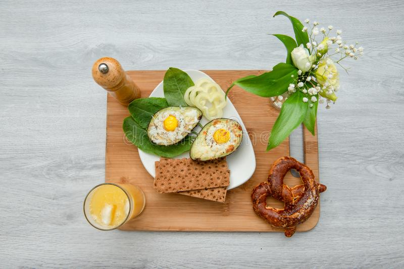 Eggs baked in avocado on plate stock photo