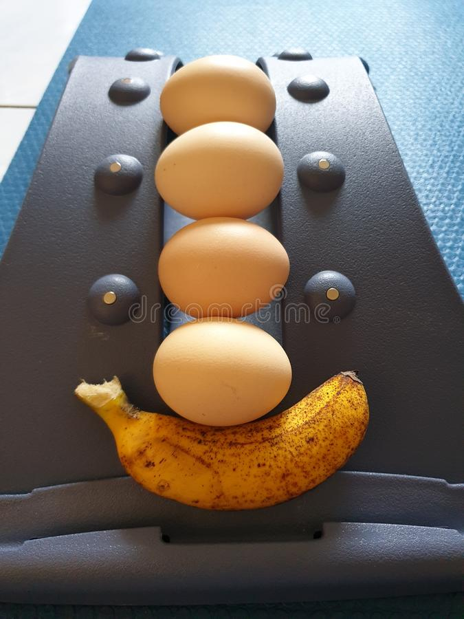 The eggs and banana with proper exercise will make us healthy and beauty stock photos