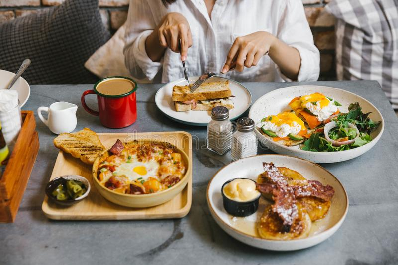 Eggs Benedict, Crispy Bacon stuffed French toast, Cheesy Potato with Crispy Bacon and Pancakes with Maple Syrup, Bacon. stock images