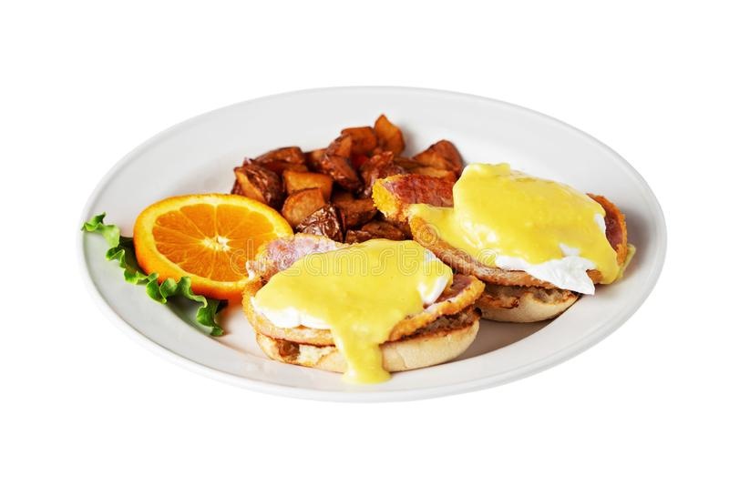 Eggs Benedict with hollandaise sauce isolated on white royalty free stock photo