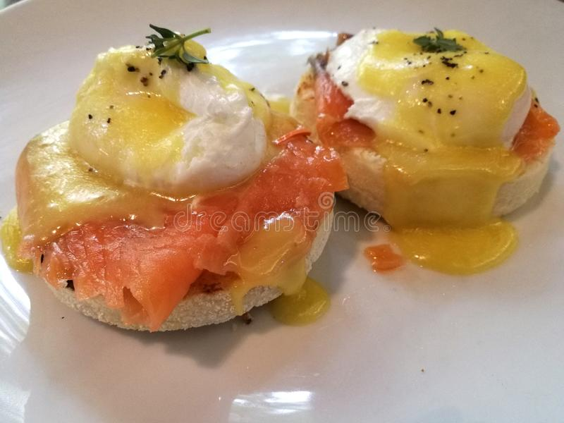 Eggs Benedict.  a traditional American brunch or breakfast dish that consists of two halves of an English muffin each of which is topped with smoked salmon, a stock images