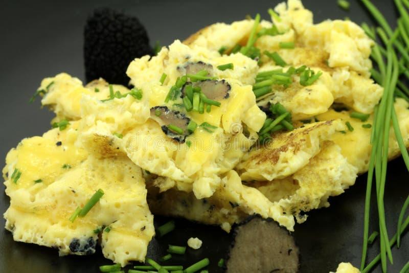 Eggs with black truffles royalty free stock photos