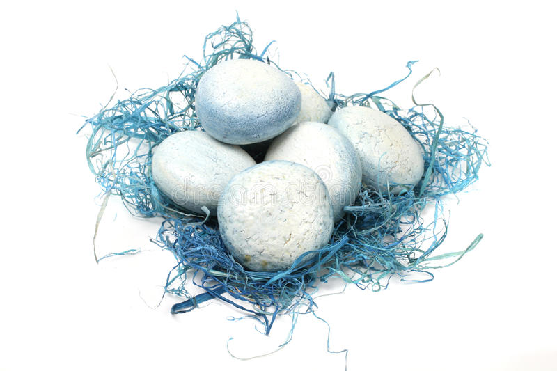 Eggs in blue nest royalty free stock photo