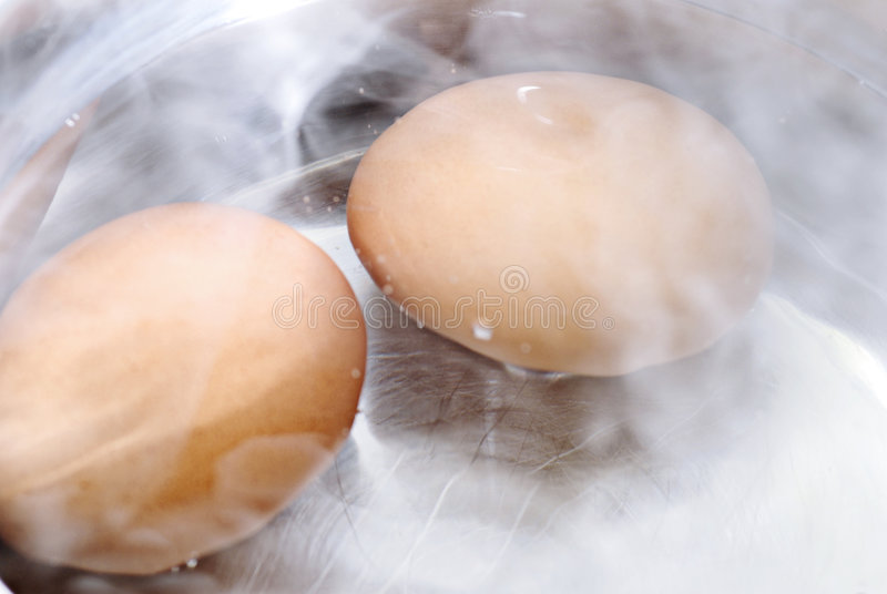 Eggs boiling stock images