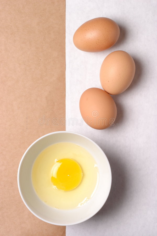 Eggs and brown paper stock images