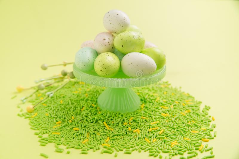 Eggs on cake stand with sprinkles stock photo