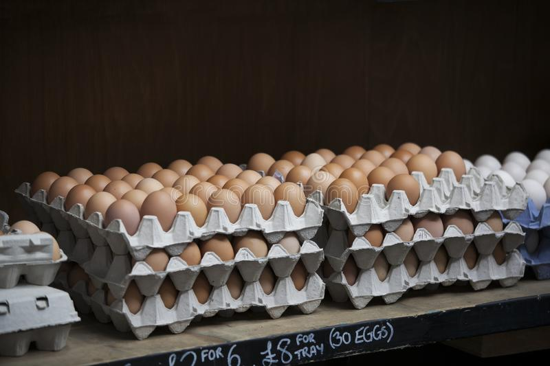 The Eggs in a cardboard box for sale on the market stock photos