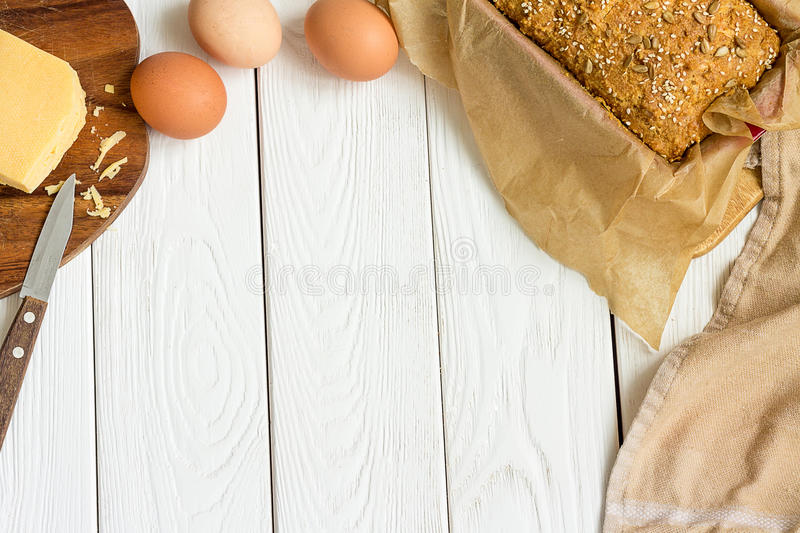 Eggs, Cheese and Homemade Gluten free Sweet Bread in the Baking Dish on a Light White Wooden Background. Rural Kitchen or Bakery - royalty free stock photos