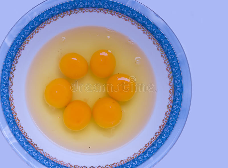 Eggs. A cluster of yolk and albumin in a bowl stock photography