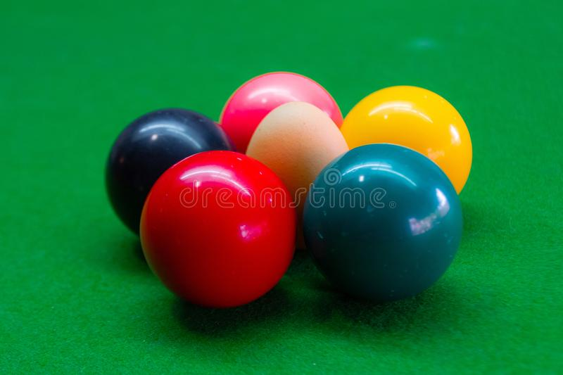 Eggs are combined with snooker balls color stock photos