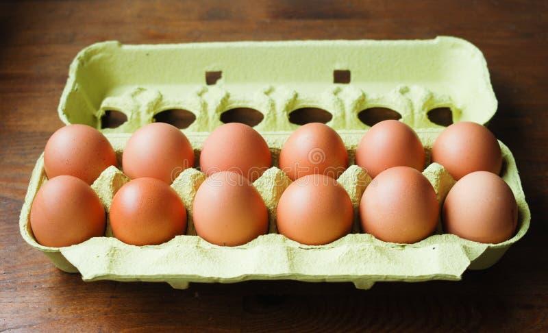 Eggs. A dozen fresh eggs in their carton