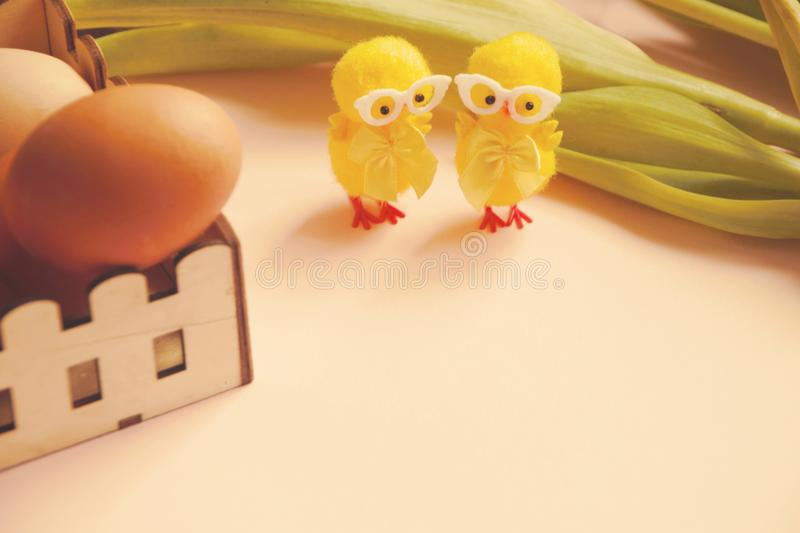 Eggs and Easter chicken cookie mold and two chic decorative figures royalty free stock photography
