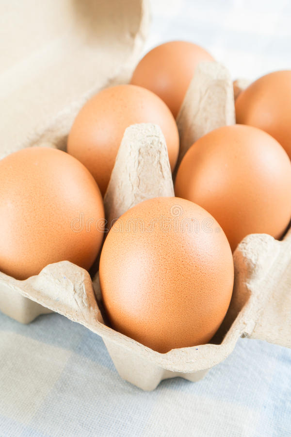 Eggs In Egg Carton On Blue Background Royalty Free Stock Photography