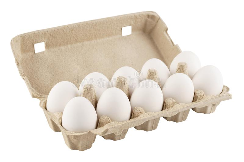 Eggs in an egg carton on a white background. Isolated. On white stock photography