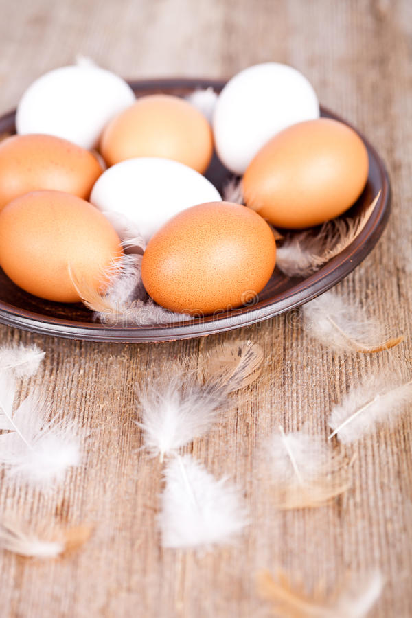 Download Eggs And Feathers In A Plate Royalty Free Stock Image - Image: 28051146