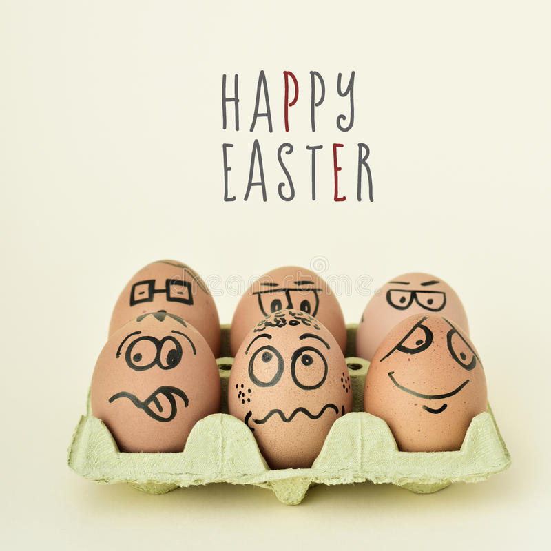Download Eggs With Funny Faces And Text Happy Easter Stock Photo
