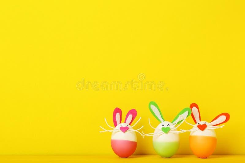Eggs with rabbit faces stock photos