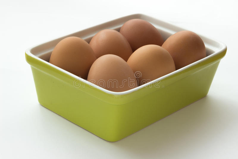 Eggs in green container. Brown eggs in green container royalty free stock images