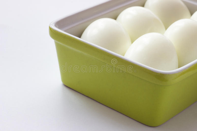 Eggs in green container. White eggs in green container royalty free stock images