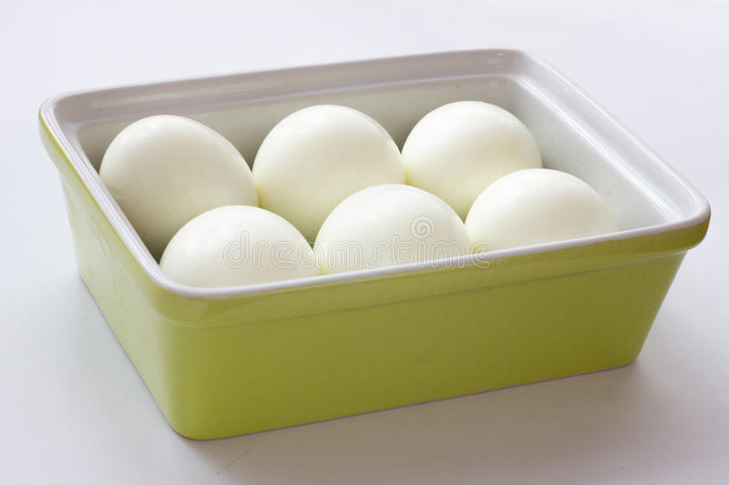 Eggs in green container. White eggs in green container royalty free stock image